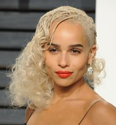 From box braids to blunt bobs, a roundup of Zoe Kravitz's best hairstyles and makeup looks, including her new platinum buzzed pixie cut.