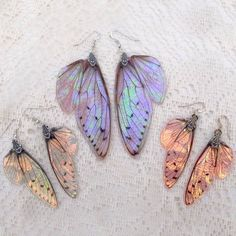 I just wanted to take a quick photo to show the size difference between my normal sized wing earrings compared to my new large wing… - Amazing Pins Cute Jewelry, Jewelry Box, Jewelery, Jewelry Accessories, Fashion Accessories, Jewelry Making, Fairy Jewelry, Resin Jewellery, Wing Earrings