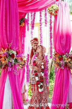 Wedding decor idea: This Indian wedding ceremony is filled with bright, cheery floral and decor! Beautiful pink decor drapes. lov it.