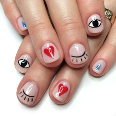 cute graphic mani with eyes and hearts