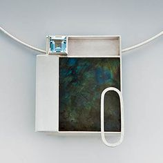 "Janis Kerman: , Necklace in sterling silver, blue topaz, and labradorite on an 18"" coiled sterling neckwire. Pendant is approx 1 1/2 x 2""."