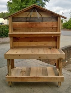 An upcycled garden work bench that I made out of pallet wood.