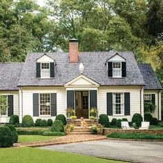 Darling colonial home with nice driveway and path to front door.