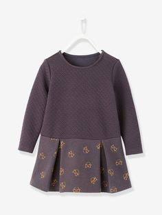 A trendy print and a comfortable fabric so she looks and feels great in her outfit!     Girl's quilted fleece dress Round neckline Press-stud fastenin