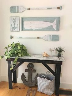 This is a large scale SET OF FOUR nautical art pieces - an anchor, a whale, and two oars with jute rope accents for a truly nautical effect! Hung as shown, the set covers an area 50 wide and 30 tall! Rustic beach house decor is perfect for a nursery, bedroom, bathroom, beach house or anywhere a little fun is needed! And, you can choose your own color scheme! All pieces are painted and then distressed using our custom techniques to create a true vintage nautical effect! - The whale is on a…