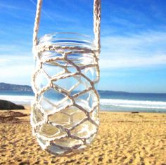 Hanging Crocheted Glass Candle Holder...i should try to make this!