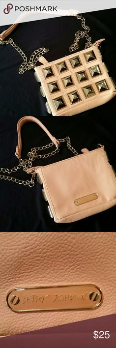 "Betsey Johnson Light Pink Studded Crossbody Bag There are a couple places where the stitching has come undone and a small spot on the bottom but overall in good condition. 7"" across, 5"" high,  1.5"" wide. 46"" chain Betsey Johnson Bags Crossbody Bags"