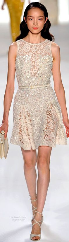 Stunning short lace dress.  Stunning Shoes.  Perfect bridesmaid's dress.  Elie Saab