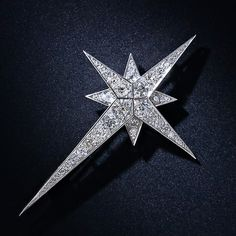 Adorn the top of your Christmas tree in high style with this stunning North Star brooch, masterfully crafted in platinum, with fine à-jour w...