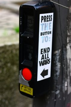 Often street art plays upon objects that are already in the public square. This sticker takes a street light button and makes it feel a whole lot more important.