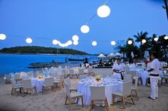 beach wedding reception Love the hanging lanterns and tables on the sand