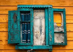 An old window in the famous tango district of Argentina - El Caminito.  http://nelmiphotography.com
