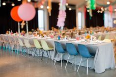 Eames style chairs at a modern wedding reception