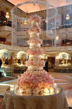 Fabulous wedding cake with gorgeous floral arrangements
