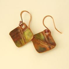 week 2 earrings .  I love to fold form metal. I make these out of copper and applied a heat patina to them.  Simple but but sweet!  check out the AJE challenge at http://artjewelryelements.blogspot.com/   and my WiredHammeredNWorn come and check it out too!