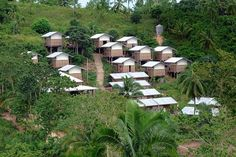 Hillside structures designed by Jean-Marie Massaud and Daniel Pouzet provide ultra-low-cost housing in one of the poorest villages on the Philippine island of Cebu.