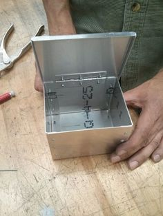 Picture of A riveted metal box with lid