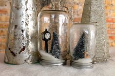 """Mason Jar Snow Globe: Stephanie Hsieh of The Naked Canvas   """"This DIY gift is a really simple way to add a darling touch to anyone's holiday decor. Because who doesn't love a good mason jar around the house?"""" Supplies:   Mason jars  Miniature figurines such as pine trees, deer, and snowmen  White glitter  Spray adhesive  Hot glue gun Steps:   1. Spray pine trees with adhesive and sprinkle glitter ..."""