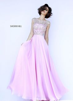 This lovely dress from Sherri Hill will be the envy of every girl at your special occasion. It has a flowing chiffon skirt and heavily jeweled cap sleeved sheer bodice over self lining. View Size Char