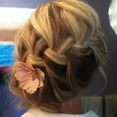 Braided into a side bun.  put snowflake where the flower is?