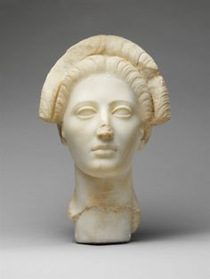 Marble portrait of a young woman.  Period:     Trajanic. Date:     ca. A.D. 98–117. Culture:     Roman.