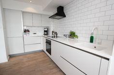 Small all white L-Shaped kitchen