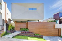 Completed in 2014 in Curitiba, Brazil. Images by Nenad Radovanovic. House set in a 319 m² plot in a gated community in the city of Curitiba. The customer demand was to build a spacious and integrated residence, in...
