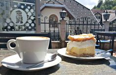Coffee and kremšnita or cremeschnitte: the best choice for a snack after a walk around the lake Bled.