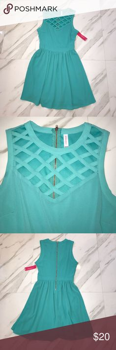 💙💚NWT A-Line AQUA DRESS💚💙 💚💙NWT beautiful a-line dress in aqua color from Target! Gorgeous caged detail in the front and zipper back. Never worn.💚💙 Xhilaration Dresses