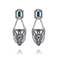 Jardins du Trocadéro Post Drop Earrings 48. Art Deco-dent trapeze earrings add a little drama + swing to your style. Sleek lines + sparkling montana + clear crystals come together for the perfect update to this c+i bestseller, also now in rhodium plating.