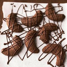 We've drizzled melted chocolate on these Almond-Chocolate-Hazelnut Crescents! More chocolaty holiday cookies: http://www.bhg.com/christmas/cookies/chocolate-holiday-cookies/?socsrc=bhgpin101612almondchocolatecrescents