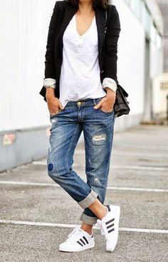 Boyfriend jeans, white top, black jacket and Adidas sneakers college outfit.