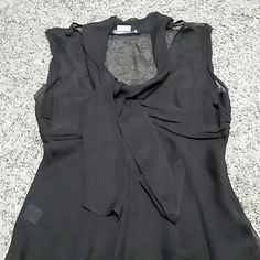 Sleeveless blouse BCBG Maxazria brown blouse, in great condition. BCBGMaxAzria Tops Blouses