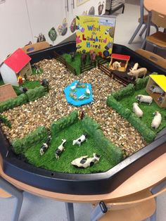 'What the Ladybird Heard' scene in a builders tray. Great to encourage the children to recreate the story during free-play!