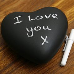 Paint a heart shaped rock with chalkboard paint