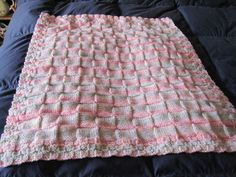 """Knitted Baby Stroller Blanket  Baby blanket pattern """"Baby Blocks"""" (with less casted on stitches) that was in Debbie Macomber's book """"The Shop on Blossom Street"""" that the character Lydia Hoffman chooses for her beginners' knitting class."""