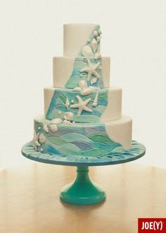 It's hot outside so I thought I'd cool you off with this breezy, ocean-themed cake design by SugarBakers Cakes. The Sea of Love cake stand is a perfect match for all the blue & green shades in the cake. And, I love the gentle cascade of shells. Let's dive right into this cake! #cake_stand, #wedding, #cakestand