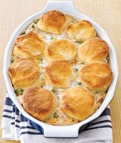 Chicken & Dumplings  4lbs cooked shredded chicken, 1 can mixed veggies, 1 can cond. cream of mushroom, 3/4 C water, S Top with 1 can Buttermilk biscuits.  Bake at 400F until it's bubbling or biscuits look done.