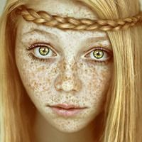 This girl is so pretty... And I bet she hated her freckles. I find them adorable