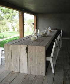 Scaffolding board table, like the way it meets the floor. Will have to show my husband this idea, it will be a great extension to his decking project: