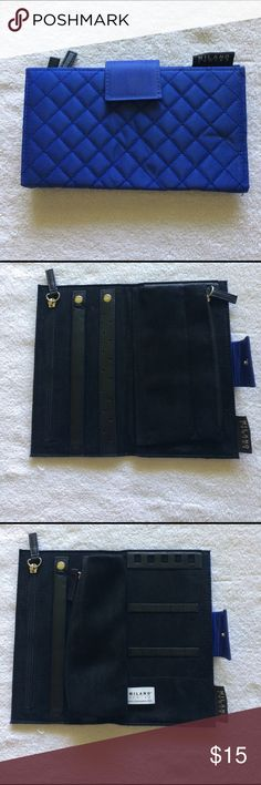 Travel Jewelry case Bright blue exterior/ black interior. Size like a large wallet. Keeps your jewelry from tangling. Inside zip pocket and zip pouch. Holds rings, earrings and necklaces. A must for traveling.  Looks new - used once. Milano Accessories