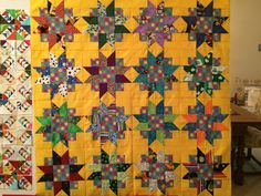 Coming Soon:  Millennium Star by Pat Speth from the Nickel Quilts book as a bright baby quilt.  Need to add borders.