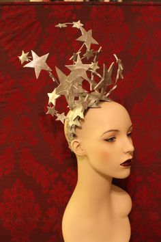 **To Order***  This is a headdress fit for a 1930's showgirl or a gal from 2013, who feels trapped in the body of 1930s showgirl. And dont we all occasionally....  Layers of beautiful sparkly silver leather stars are carefully attached to millinery wire and then carefully attached to a headband. Each star is hand cut and double layered. Each side of the star is hand painted in a silver and adorned with silver glitter, so whichever way you are viewed, you look heavenly. The headdress is super…