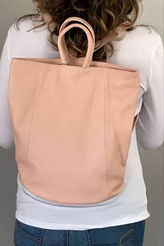 It's a functional and stylish backpack purse! This pebbled Italian leather bag has a spacious main compartment with a zipper closure and a turn lock to keep unwanted hands out of your stuff. Great for traveling, commuting to work or just everyday. Lots of colors. #leatherpursesandwallets #leatherbackpackpurse #summerstyle #summerbags #tophandlebag #convertiblebackpack #backpackpurse #travelbackpack #travelbagsforwomen #tote #workbag #pinkbag #onthego