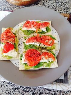 Healthy snack with avocado,feta and garden tomatoes