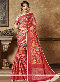 Be an angel and create and establish a smashing impression on everyone by wearing this red banarasi silk traditional designer saree. The resham and zari work looks chic and aspiration for any get toge...