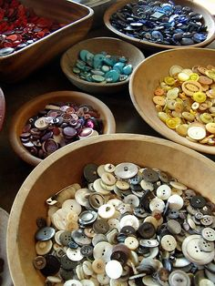 Sorted buttons in wooden bowls; bowls - buttons - buttons bowls.  I love them all.  How useless, but how beautiful!