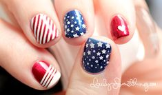 Bases are Nicole Listen to Your Momager (blue), A-England Perceval (red)  Stamping Color: Konad White  Stamping Plates: Konad m84 (stars), Cheeky Jumbo Image Plate I2 (diagonal stripes & pointer finger)  Heart: China Glaze White on White  From: The Daily Something  #july4 #xmas #redwhiteblue