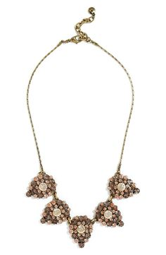 Dramatic, vintage-inspired crystal teardrops style this antiqued chain necklace that lends frosty sparkle to any look.