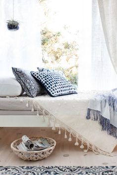 summer bench with blue and white throw pillows